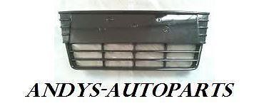 FORD FOCUS 2011 - FRONT BUMPER GRILLE CENTRE SECTION NO SENSOR HOLES GLOSS BLACK